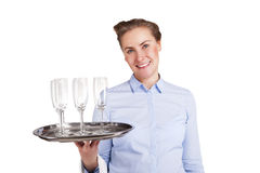 Woman in waiter uniform holding tray with glasses, smiling, Royalty Free Stock Photo