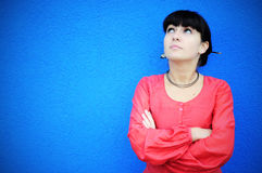 Woman waiting. Image of a young woman with her arms crossed waiting Royalty Free Stock Photo