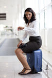 Woman waiting at the airport Stock Image