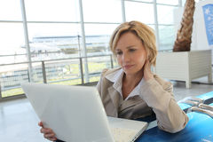 Woman waiting in airport Stock Photos