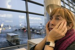 Woman waiting in airport stock image