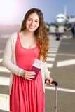 Woman waiting in an airport Stock Photography