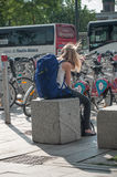 Woman waiting with backpack in front of train station in Mulhouse Royalty Free Stock Photography