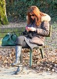 Woman waiting on the bench Royalty Free Stock Photography