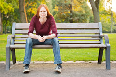 A Woman Waiting on a Bench in a Park Royalty Free Stock Photos