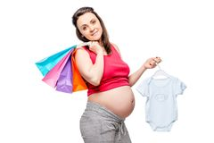 Woman waiting for the birth of her son, portrait after shopping. On a white background Stock Photo