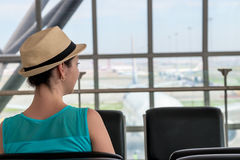 Woman waiting for boarding flight royalty free stock photography