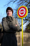 Woman waiting at bus stop. Women waiting for bus, standing next to bus stop Stock Image
