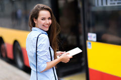 Woman waiting at bus stop Stock Photo