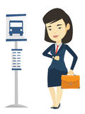 Woman waiting at the bus stop vector illustration. Asian business woman waiting at the bus stop. Young business woman standing at the bus stop. Woman looking at Royalty Free Stock Photos