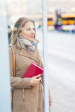 Woman Waiting at Bus Stop Stock Photos