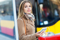 Woman Waiting at Bus Stop Stock Photography