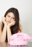 Woman waiting for call. Young beautiful woman waiting for call royalty free stock image