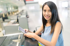 Woman waiting for check in counter Stock Photo