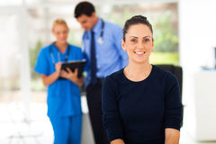Woman waiting checkup. Portrait of smiling women waiting for checkup in doctor's office Stock Photo