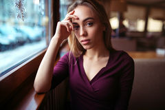 Woman waiting in coffee shop Stock Image