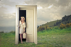 Woman waiting at the door Royalty Free Stock Images
