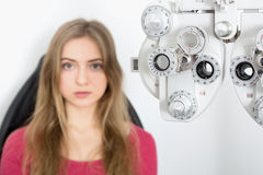 Woman waiting for eye examination with phoropter Stock Photography
