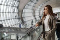 Woman waiting for flight in airport royalty free stock images