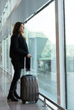 Woman waiting for flight Stock Images
