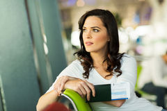 Woman waiting flight. Pretty woman waiting for her flight at airport Royalty Free Stock Images