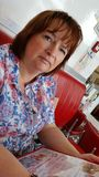 Woman waiting on food. Being served in restaurant Royalty Free Stock Images