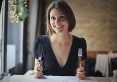 Woman waiting for food Stock Photography