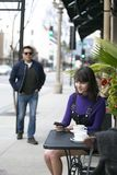 Woman Waiting for a Friend at a Local Sidewalk Cafe royalty free stock image