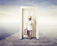 Woman waiting in front of a door Royalty Free Stock Image