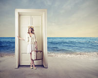 Woman waiting in front of a door Royalty Free Stock Images