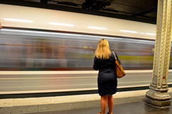 Woman waiting in front of moving subway train. Woman waiting front of moving subway train in Paris, France Royalty Free Stock Photos