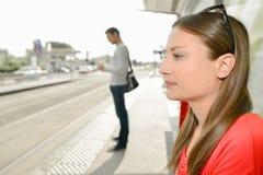 Woman waiting got tram to arrive Stock Photos