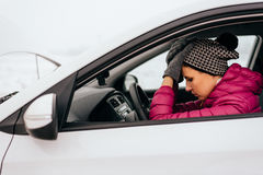Woman waiting for help or assistance - winter car breakdown Royalty Free Stock Photo