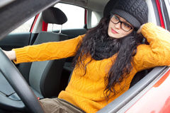 Woman waiting in her car. Resting in her arm Stock Photo