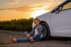 Woman waiting beside her car on a rural road Royalty Free Stock Photography