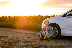 Woman waiting beside her car on a rural road Royalty Free Stock Image