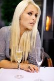 Woman waiting for her date. Young beautiful woman waiting for her date on a restaurant Royalty Free Stock Photography