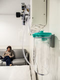 Woman waiting in her husband`s room in the hospital Stock Photos