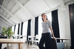 Woman waiting of her lunch in a modern cafe. coffee break, early breakfast, funny mood, image of young pretty girl Royalty Free Stock Image