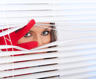 Woman is waiting with hope near window Stock Photo