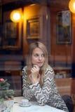 Woman waiting inside an elegant cafe Stock Image