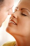 Woman waiting for kiss. Beautiful woman smiling with eyes closed waiting to be kissed by man Stock Image