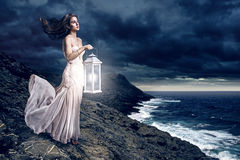 Woman waiting. With a lantern Royalty Free Stock Photos