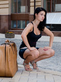 Woman waiting for a lift Stock Photography