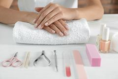 Woman waiting for manicure and tools on table. Spa treatment. Woman waiting for manicure and tools on table, closeup. Spa treatment royalty free stock photos