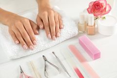 Woman waiting for manicure and tools on table. Spa treatment. Woman waiting for manicure and tools on table, closeup. Spa treatment stock images