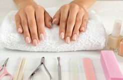 Woman waiting for manicure and tools on table. Spa treatment. Woman waiting for manicure and tools on table, closeup. Spa treatment stock photos