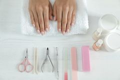 Woman waiting for manicure and tools at table. Spa treatment. Woman waiting for manicure and tools at table, top view. Spa treatment royalty free stock photography