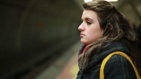 Woman waiting metro at station stock footage