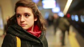 Woman waiting metro at station stock video